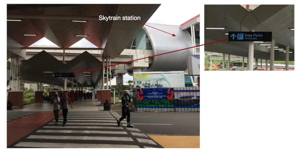 Outside the arrival terminal, lack of Railink wayfinding